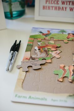 in lieu of a guestbook, write on the back of a puzzle for a baby's birthday!