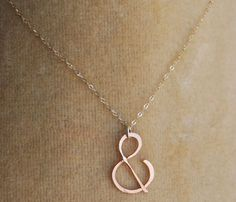 Rose Gold Ampersand Necklace    not totally sure why just yet...... but I really like this??