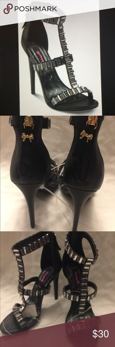 Betseyville Mykonos Embellished Heels. nwot Black Embellished Leather Heeled Sandals. Textile with man made material. Man made material outsole. Has white stones over straps . Has back zipper in back of shoe. Heel is 5 inches . With 1/2 inch sole on palm of foot . Betsey Johnson Shoes Heels