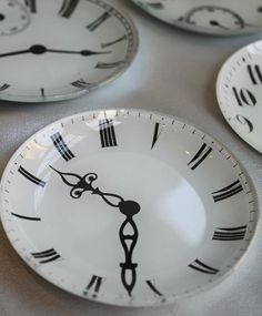 Clock plates. DIY with dollar tree plates and permanent marker baked to seal