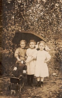 Victorian girls with the strangest doll--look at the size of the doll's head vs her hands and feet!