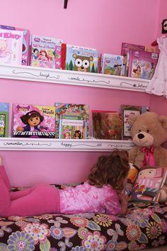 Kids book nook (using baby crib mattress & rain-gutter bookshelves)