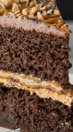 Chocolate Dulce de Leche Cake ~ Filled with a thick caramel and fluffy frosting, then topped with toffee bits and extra dulce de leche!