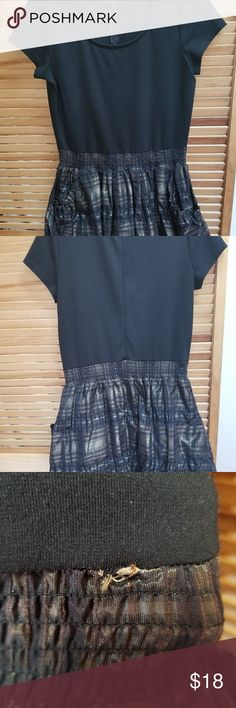 "Michael Kors Black/Brown Plaid Bubble Pocket Dress Cute pre-owned black and brown Michael by Michael Kors dress. The dress is a size 10, and is pretty short because of the bubble hem skirt.   The dress zips in the back and has a hook-and-eye closure at the top of the zipper.  Known damage (see pictures):  1) ""Pilling"" on much of the top of the dress, due to wear over time   2) Hem is beginning to pull away in several areas where skirt meets top, creating small holes around the dress at the…"