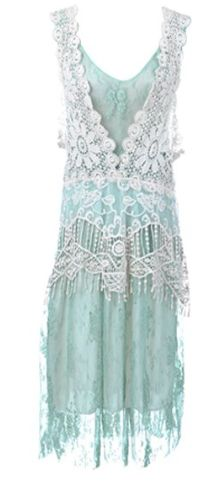 Lovely lace vintage-style dress looks great with a white cloche summer hat and beige mary jane patent leather pumps. Dress $47.90, hat $44.95, shoes $29.99