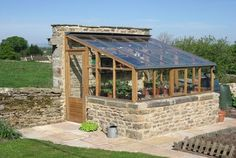 stone and wood greenhouse lean-to