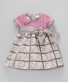 A sweeping floral pattern and velvet bodice bring the best out of this frock's design. Sweet on little ladies, it has a zipper in the back and a pretty sash that goes around the waist.