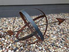 Arrow sphere yard art from whiskey barrel rings and rebar