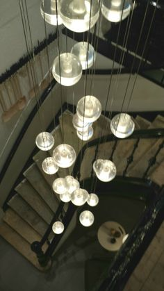 Mobilia hanging globe lights, staircase
