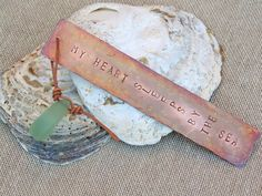 By The Sea Bookmark - With a rustic sea shore driftwood feel to it, this bookmark has 'my heart sleeps by the sea' stamped onto it.