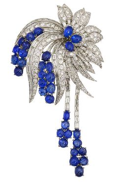 A sapphire and diamond brooch, circa 1950 designed as a spray of round brilliant and baguette-cut diamonds, accentuated by oval-shaped cabochon sapphire clusters