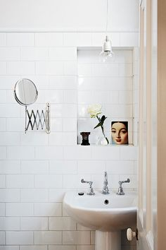 bathroom with a small mirror.