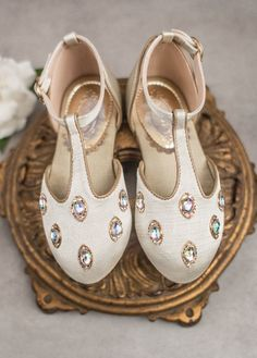 These special little shoes include vintage-inspired embellishments with iridescent jewels. Finished with Dupioni silk, these flats are sure to become her favorite.