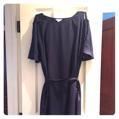 Navy Lilly Pulitzer Dress Navy blue with beautiful cut out shoulders with beading. Front and back are plain navy but the shoulders of the dress more than make up for that. It does have a little sash belt that you can tie in to accentuate your waist. This dress is brand new never worn! Lilly Pulitzer Dresses