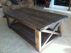 rustic coffee table with carpet and sofa