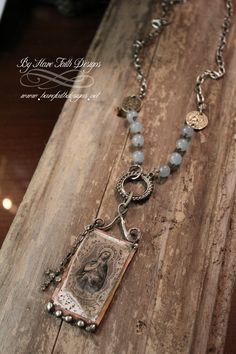 """Rosary style necklace, pendant is hand forged aged copper with solder details, replica vintage image sits below aged glass. Swirling wire top connects pendant to long 32"""" chain of metal and"""