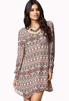 A shift dress featuring a boho pattern and a cutout back. Round neckline. Long sleeves with button cuffs. Patch pocket. Fully lined. Woven. Lightweight.