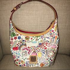 ❤Dooney & Bourke Whimsy in White  This gorgeous RARE Bucket Bag is from the Whimsy Collection by Dooney and Bourke. This bag is meager exterior with a cotton interior. Also has a single buckle adjustable strap. Signature logo-engraved metal plaque on front. Top zip closure. Lined-interior features a back wall zip pocket and slip pocket. Bottom Width: 8 1 ⁄ 2 in Middle Width: 9 in Top Width: 9 1 ⁄ 2 in Depth: 5 1 ⁄ 2 in Height: 6 in Strap Length (long): 8 in Strap Length (short): 6 in Weight…