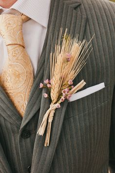 A wheat boutonniere for the groom has loads of rustic charm | The Melideos