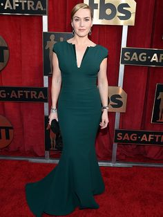 Kate Winslet showed up to the Screen Actors Guild Awards looking fabulous a usual — but she didn't know that until she actually saw herself on the red carpet. John Shearer/Getty