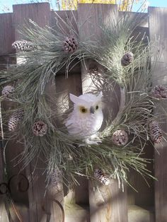 Winter Holiday Owl Wreath- Snow Glittered Pine Cone Accents Christmas Decor. $58.00, via Etsy.