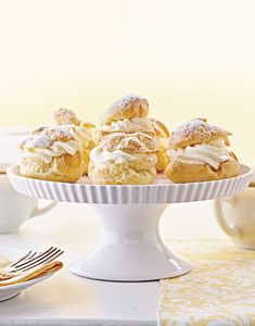 These little two-biter French desserts are both delicious and fun to make. Pâte à choux is a thick and sticky pastry dough that's piped into puffs and baked with hollow shells, perfect for holding creamy fillings, like this lemon one. French Desserts, Lemon Desserts, Lemon Recipes, Cream Recipes, Dessert Dishes, Dessert Recipes, Mini Peach Pies, Almond Pastry, Thing 1