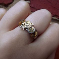 'What lies within' Unisex Steampunk watch gear ring - I don't wear rings, but if I did, this would be it!