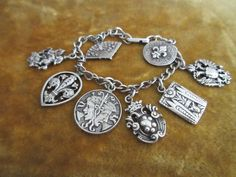 Older vintage sterling charm bracelet with wonderful double sided charms. I would date this estate treasure at least back to the 1940s and I think it
