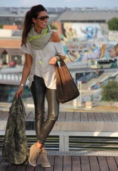 Audrina?? Camo with leather pants and a wedge sneaker. Nice move