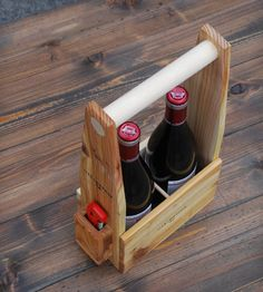 Two Bottle Wine Carrier - you could so easily make this a DIY project, buy a couple of bottles of wine, tie a pretty ribbon on this and give it as a house warming gift....