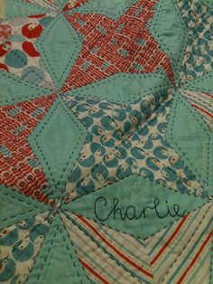 love the contrasting color hand quilting detail on this
