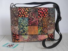 Batik patchwork crossbody messenger bag in rich autumnal shades Patchwork Bags, Quilted Bag, Crossbody Messenger Bag, Satchel, Crossover Bags, Belt Bags, Batik, Card Wallet