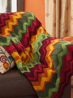 Free Pattern - Bold chevron stripes knit in spicy shades make this #knit blanket a great way to add warmth a home.