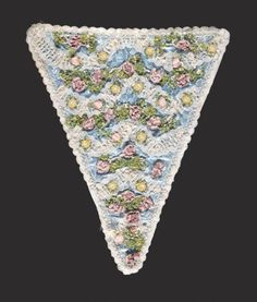 Womans StomacherFrance, mid-18th centuryCostumes; principal attire (upper body)Ombré ribbon, silk thread, fly fringe and lace on silk damaskLength: 15 in. (38.1 cm)Gift of Mrs. Gabriella K. Robertson and Mrs. Marlene P. L. Toeppen (63.2.5)
