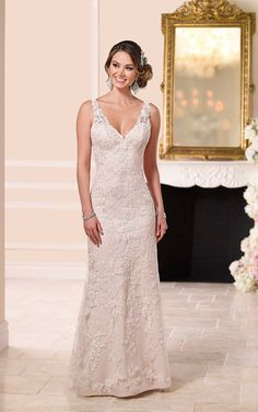 Stella York does it again with this lace over matte-side lustre satin sheath wedding dress featuring hand-sewn clear beading. The semi-illusion lace back back zips up under crystal buttons, & the skirt skims the floor into a magnificent fan train.