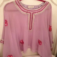 Sheer top Light purple chiffon top size medium. Detailed embroidered stitching in silver, pink and purple. Swarovski crystal stone accents. Can be worn for day or evening. Can be worn 2 different ways on the arms. Beautiful details. Selanoora Tops