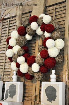 Yarn ball wreath with twine, cream, and red. Yarn is wrapped around crumpled up newspaper to make it on the cheap! Could use Super Saver yarn and even a cardboard form in the back (or pool noodle!!).