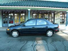 1998 Mazda Protege: Heather's car brought into the marriage. A green twirp of a car - didn't last long in the fam.