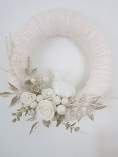 white winter wreath - add some champagne or gold accents to match our tree