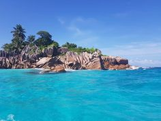 From the rock formation to the blue skies and sea to the green trees soaking in the sun. Fitting perfectly together to form the perfect piece of paradise. Rock Formations, Blue Skies, Green Trees, Another World, Seychelles, The Rock, Beaches, Paradise, Relax