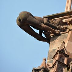"""Defecating person"" Gargoyle - south side Cathedral of Our Lady (Münster) Altstadt, Freiburg im Breisgau, Germany"