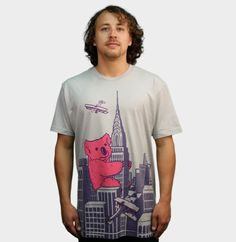 It's a giant pink koala bear climbing a building. Do you love this shirt from Design by Humans?