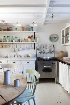 rustic kitchen, butcher block counters, white pendant lights, open shelving