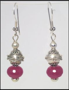 http://www.sellergroup.com/shop/TelumaDesigns  Ruby Red faceted crystal Earrings with Sterling Silver beads. Stunning, exotic style earrings, OOAK, handmade by Teluma Designs. Matching bracelet available. (Code 258E)