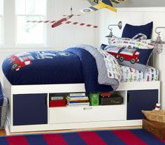 Love the model airplanes hanging from the ceiling! Also, just bough this sheet set. Pictured is from Pottery Barn Kids, July 2013