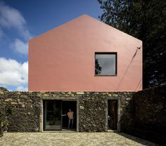 Italian studio Mezzo Atelier chose a vibrant shade of pink for the walls of these guesthouses in the Azores, which are housed inside a converted stable