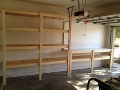 Garage shelves and workbench. Workbench on the opposite side of the garage as the door to the house. Garage House, Garage Shelf, Basement Shelving, Diy Garage Storage Shelves, Wooden Garage Shelves, Diy Garage Work Bench, Garage Shelving Plans, Ceiling Shelves, Wall Shelving