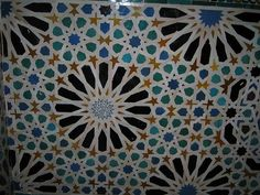 Decorative mosaic tiled wall in the Nasrid Palace, Alhambra, Granada, Spain