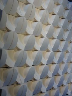 """""""Modular Ceramic Wave Wall White"""" by Eric Pilhofer, module dimensions 6 x 6 inches, slip cast stoneware with glaze."""
