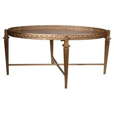 Showcasing a gold tone finish and decorative tapered legs, this lovely coffee table is perfect for adding a touch of shimmer to your home library or living r...